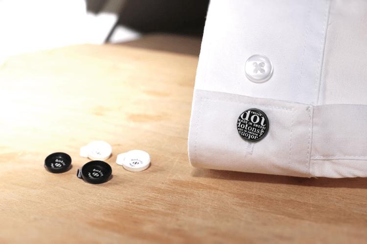 Knoopcover als subtiele logodrager